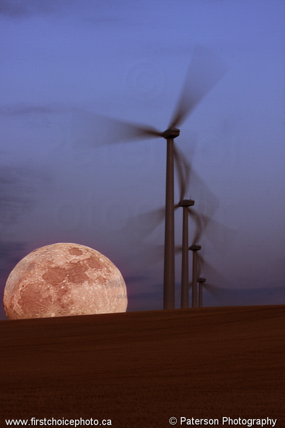 Southern alberta windmills with a full moon